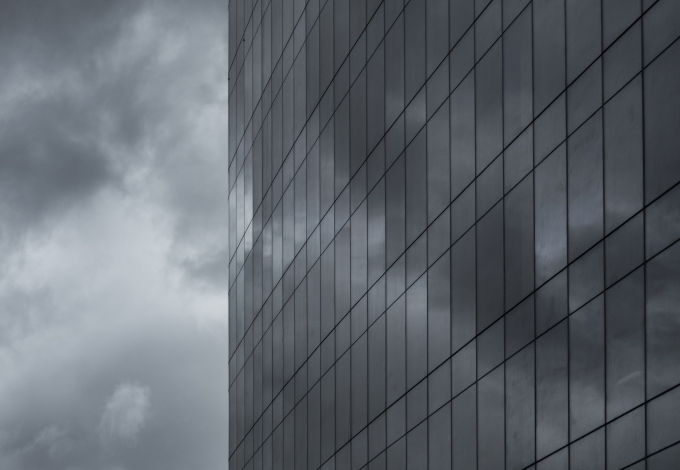 negative-space-clouds-reflecting-on-skyscraper